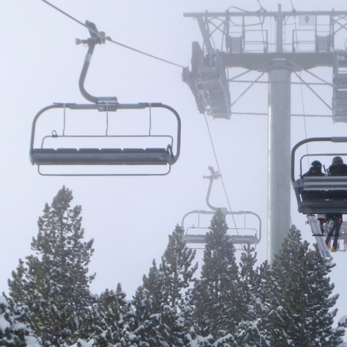Esprit | Ski lift through the snowy tree tops