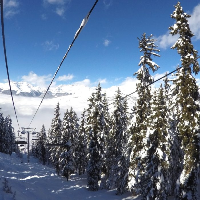 Esprit | A chairlift through the snowy trees in Peisey