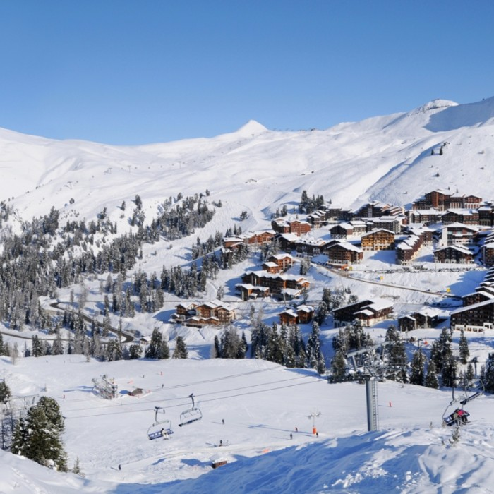 Esprit | A view of Belle Plagne, with snow and trees